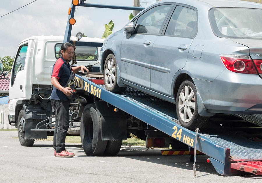 Selangor Malaysia - 07 August 2017: A car has broken down and being pulled up into the tow truck.